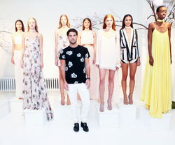 Andrew pictured with several models