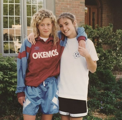 Cynthia Frelund (right) and a friend in their Okemos High School​ soccer uniforms [9]​