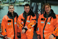 Inaugural Class Flight Members conduct underwater emergency egress and sea survival training with Survival Systems, USA in Groton, Connecticut, June 2011. (L to R): Brian Shiro,                                     Christopher Altman                                    , Jason Reimuller.