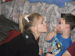 Kayla Sprinkles trying to kiss a young boy [4]