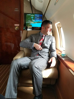 Seated in a private jet