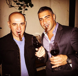Enjoying cigar and wine with a friend