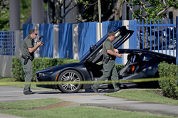 Broward County Sheriff's Office deputies examining the BMW i8​ XXXTentacion​ was fatally shot in [33]​