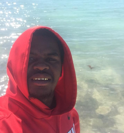 Selfie​ of Dedrick Williams at the beach [7]​