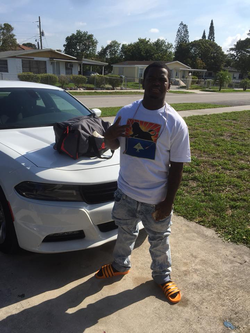 Dedrick Williams standing in front of a Dodge Charger​ [7]​