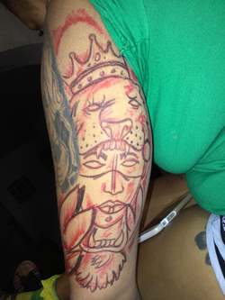 Tattoo done by Dedrick Williams [7]​
