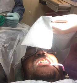 Photo of Dedrick Williams at the dentist​ [7]​
