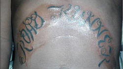 Dedrick Williams says he inked this tattoo on the abdomen of rapper Kodak Black​. [5]​