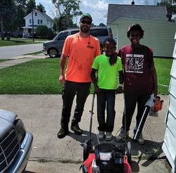 Reginald 'Reggie' Fields receiving a new lawn mower by generous supporters.