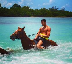 Younes Bendjima  riding a horse in Jamaica [11]