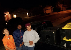 DBangz with his friends out in the night standing by cars.