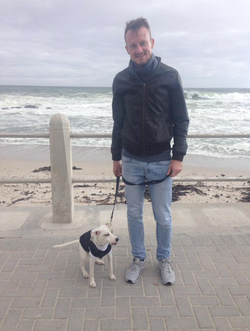 Jared Rossouw                              with his dog.
