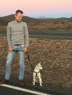 Jared Rossouw                              with his dog as the sun sets.