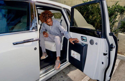 "Photo of Tyreil Jones inside of a  Rolls Royce  ​ that is posted on Facebook with the following message: ""Money may not buy happiness, But it's better to cry in a Rolls Royce."""