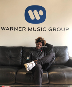 Tyreil Jones  waiting for a scheduled meeting inside of  Warner Brothers  ​ headquarters.