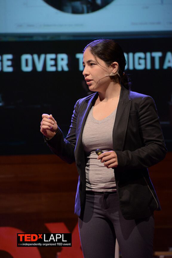 America Lopez presenting at a  TED Talk