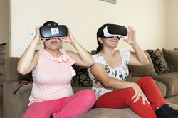 The CyberCode Twins wearing  VR  headsets