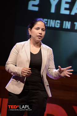 Penelope Lopez presenting at a  TED Talk