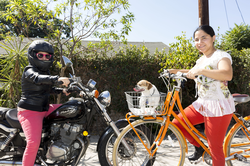 America and Penelope Lopez on bikes