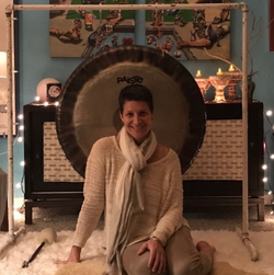Pilar Stella Ingargiola                              with her gong from a sound bath.