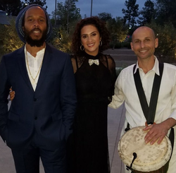 Nissim Malul with Ziggy Marley​ and another woman.