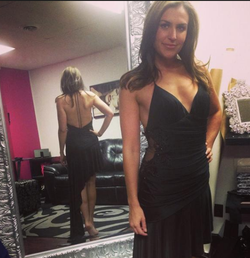 Erin Como dressed in black