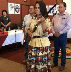 Chiricahua Apache Nde Nation 2018                                                Chairwoman of the White Mountain Apache reservation receiving a War rifle from the jicarilla Apache