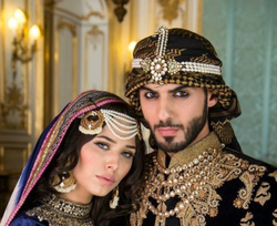 Omar Borkan posing with Ayyan for the cover the Winter 2013 Asiana.TV photo shot