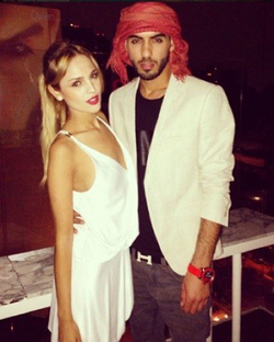 Omar Borkan with a friend; he is a styling a keffiyah and western wear (white jacket and traditional jeans)