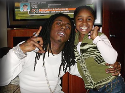 A younger Reginae with her father Lil Wayne​
