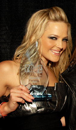 Alexis Texas holding her 2010                                 F.A.M.E. Award                                trophy for Favorite Ass