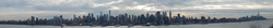 The skyscrapers of New York City, the most populous U.S. city with 8.6 million residents in 2015, are mostly situated in Manhattan, seen here in this panorama viewed across the Hudson River from Weehawken, New Jersey, in January 2015. One57 and 432 Park Avenue are noted left of center; the Empire State Building, right of center; and on the far right of the picture, One World Trade Center, the tallest skyscraper in the Western Hemisphere, as well as Four World Trade Center, 70 Pine Street, the Woolworth Building, and 40 Wall Street. At the center of the skyline picture, the Chrysler Building, The New York Times Building, and the Conde Nast Building can be picked out of the crowd by their spires.
