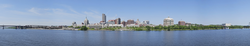 Panorama of the state capital Albany and the Hudson River from Rensselaer. At the left foreground is the System Administration Building of the State University of New York. The tallest skyscraper visible is one of several buildings in the Empire State Plaza governmental complex.