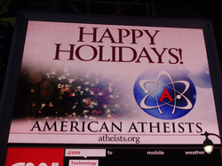 Atheism, promoted on an electronic billboard in Times Square, is observed by a significant proportion of New Yorkers.