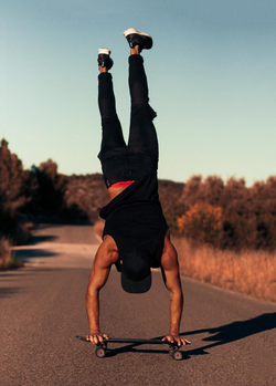 Sergio doing a handstand on a skateboard