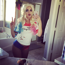 Another photo of SSSniperWolf cosplaying as DC Comics'Harley Quinn.