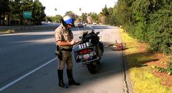 A motorcycle sergeant on the                                 San Tomas Expressway                                near Benton Avenue in                                 Santa Clara, California                                .