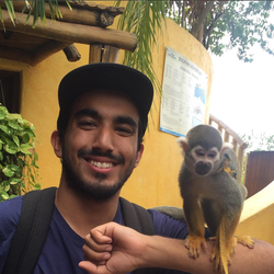 Wahlid holding an exotic animal.                                                                  [5]