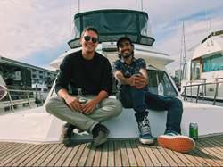 Wahlid with a friend near yachts. [5]