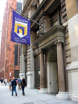 Flags identify NYU buildings around the city. This flag is for the                                 Gallatin School of Individualized Study                                .