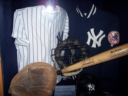 The mask and catcher's mitt of                                 Thurman Munson                                , the team captain who was killed in a plane crash in 1979