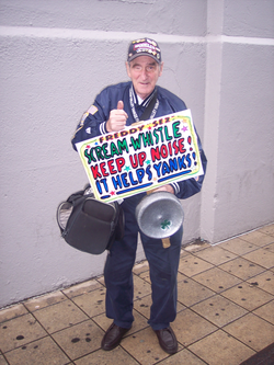 """                                 Freddy Sez                                "" holding one of his signs near the bleachers entrance before a game between the Yankees and the                                 Texas Rangers                                ."
