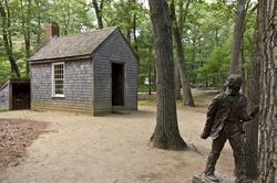 Replica of Thoreau's cabin near Walden Pond and his statue