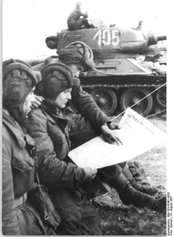 Soldiers in an                                 East German                                tank unit reading about the erection of the                                 Berlin Wall                                in 1961 in the newspaper                                 Neues Deutschland