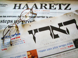 Israeli daily newspaper                                                   Haaretz                                                 , seen in its                                 Hebrew                                and English language editions