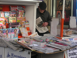 Newspaper vendor,                                 Paddington                                , London, February 2005