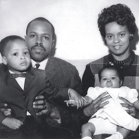 Fraser Robinson III and Marian Robinson pose with their son Craig and infant daughter Michelle in a 1964 family portrait.