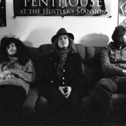 on a couch with hats