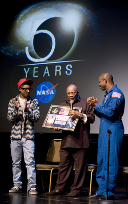 Williams and American astronaut                                 Leland D. Melvin                                present a montage to record producer                                 Quincy Jones                                .