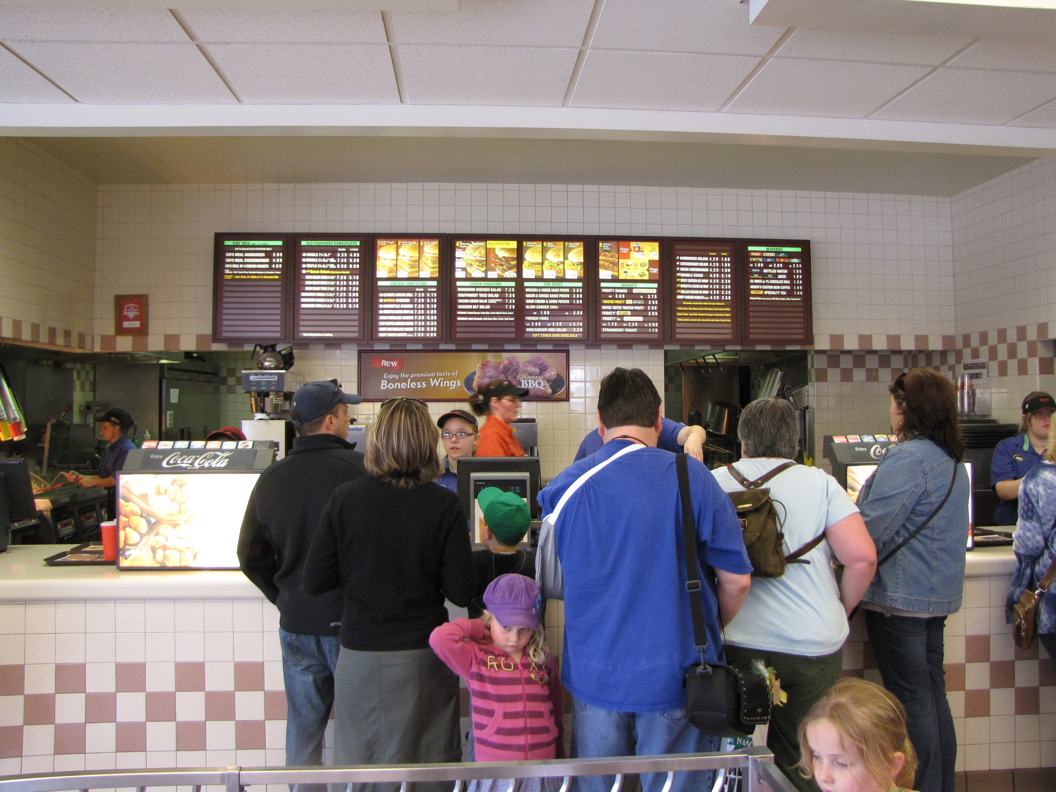 A busy front counter at a Wendy's restaurant in Niagara Falls, Ontario